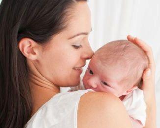 hold-newborn-baby