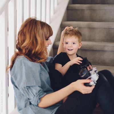 A portrait of mother and son sitting on the stairs