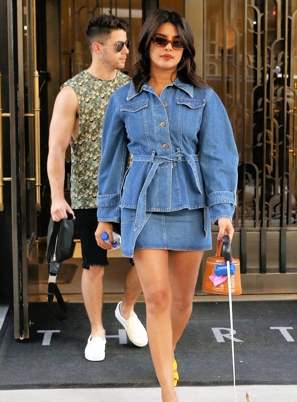 Priyanka Chopra Takes On Double Denim In Mini Skirt & Belted Top While Walking Dog With Nick Jonas