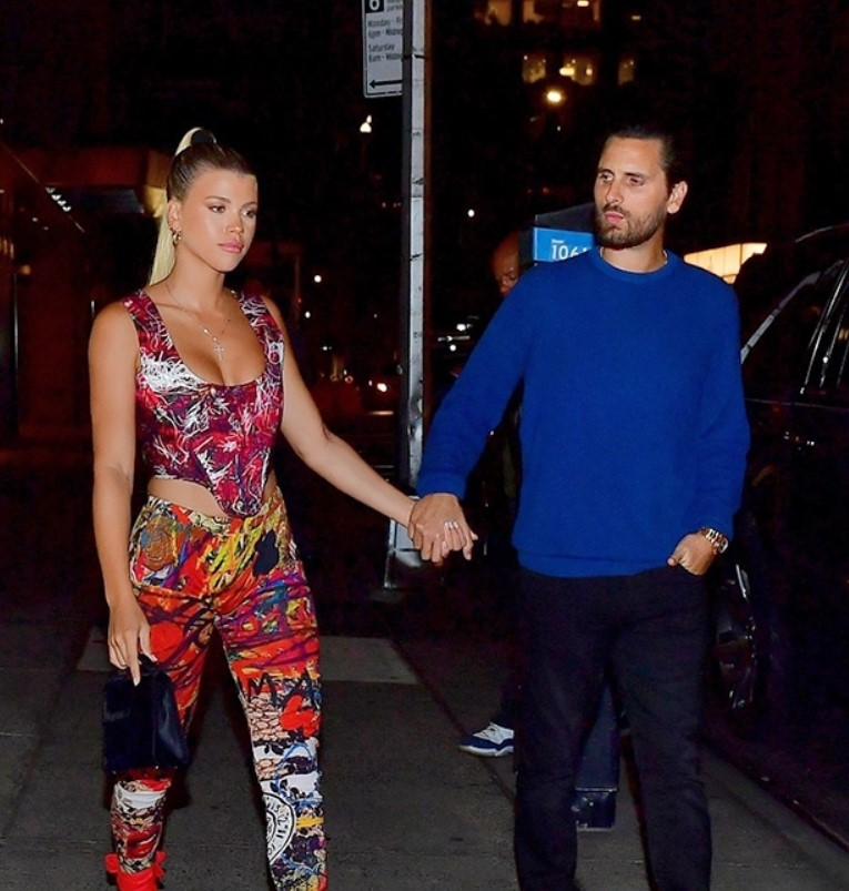 Scott Disick Gives Sofia Richie A LovingLook As She Stuns In Electric CutoutJumpsuit & Sleek Updo
