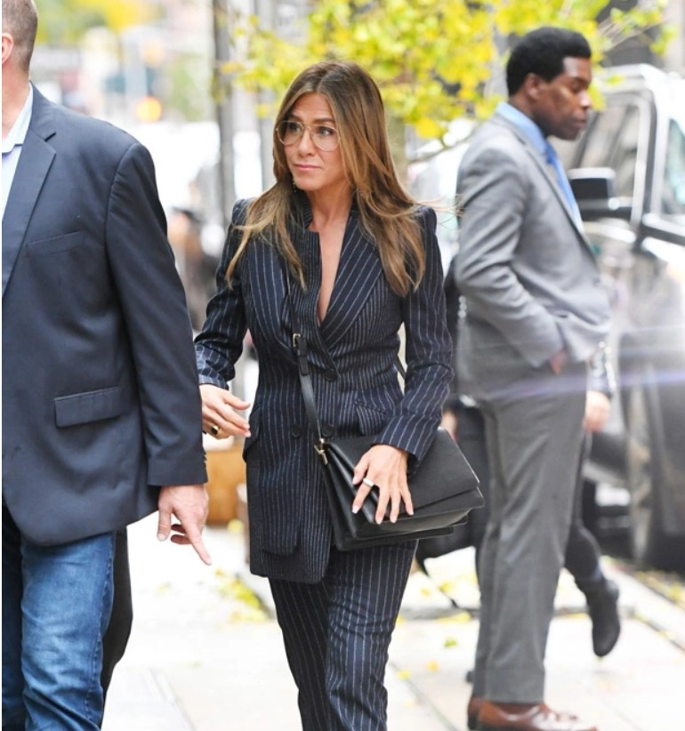 Jennifer Aniston Rocks Pinstripe Suit WithNothing Underneath & 15 More StarsTrying The Trend