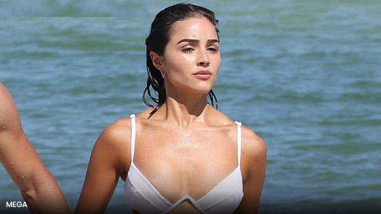Olivia Culpo Rocks White Crop Top WithNothing Underneath In BTS Look At 'SISwimsuit' Shoot